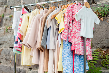 The collection spring-autumn clothes for girls on hangers