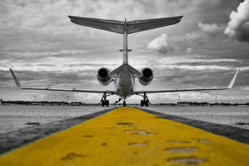 Colour key of a Learjet 31 on a cloudy day Wall mural