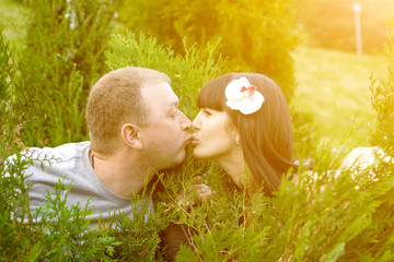 Closeup of couple in love kissing. Summer in the sun.