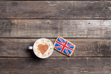 british flag shaped cookie and cup of coffee on the wonderful brown wooden background Fototapete