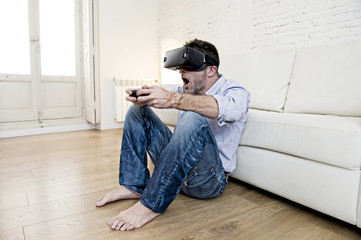 man at home living room sofa couch excited using 3d goggles play