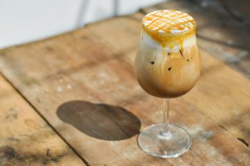 Ice caramel macchiato on wooden table