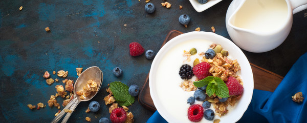 Greek yogurt with granola and fresh berries. Healthy food.