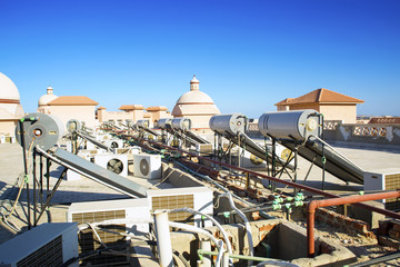 conditioners and tanks for heating of water on a roof of the egyptian building - Lucarne Moderne Et Toit Tuile