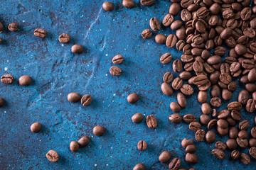 roasted coffee beans on blue table, can be used as a background