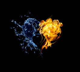 Burning heart. Heart in fire and water isolated on black background
