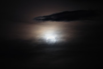 Full moon beautiful over dark black sky at have raincloud in night