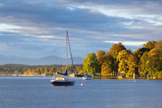Germany, Bavaria, sailing ship on Lake Starnberg in the morning