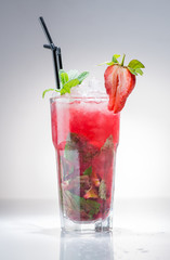 strawberry Mojito cocktail with lime and mint