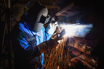 Welding steel structures and bright sparks in construction industry.