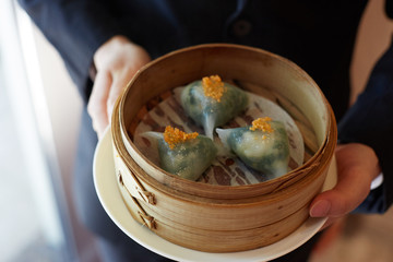 Traditional Chinese dumplings in bamboo steamer