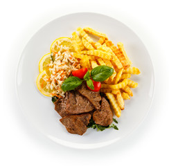 Roasted steak with french fries and vegetable salad