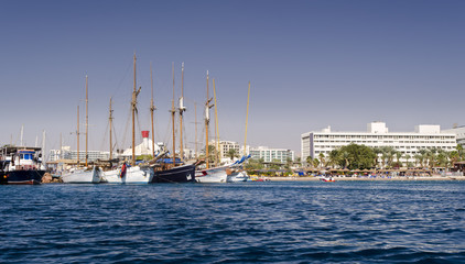 Moored pleasure boats, sailboats and yachts in marina of Eilat - famous resort and recreation city in Israel