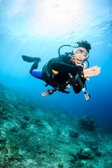 Canvas Prints Diving Happy SCUBA diver on a coral reef