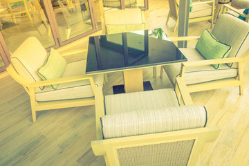 Tables and chairs in restaurant . ( Filtered image processed vintage effect. )
