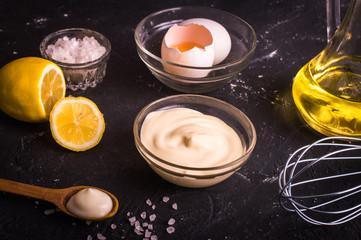 Mayonnaise on a dark background. Ingredients mayonnaise