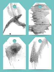Set of vector grunge dark tags. Abstract strokes of black paint on a white background.  Collection of hand drawn labels. Can be used as backgrounds for your titles or as  printable badges.