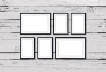 Black photo frames set on old painted wooden panels