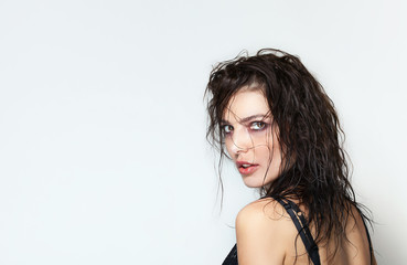 Beautiful woman back portrait with wet hair looking at camera