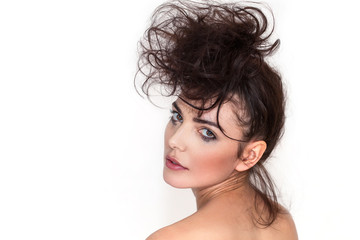Pretty woman portrait with messy hair and smudged makeup looking back