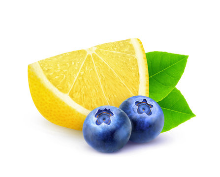 Isolated fruits. Slice of lemon and two blueberries isolated on white background with clipping path