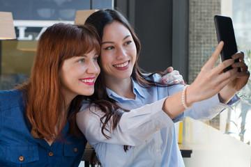 Two pretty friends take a selfie