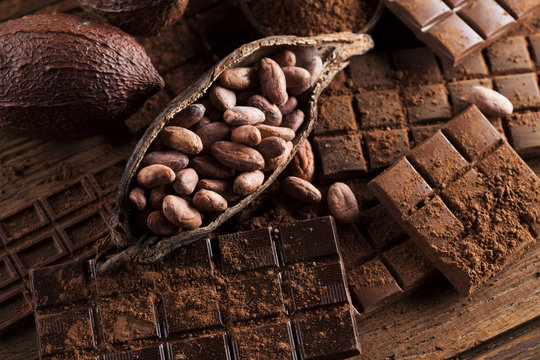 Chocolate bar, candy sweet, dessert food on wooden background