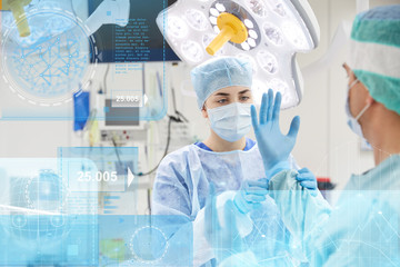 surgeons in operating room at hospital