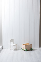 children room concept small chair and box white decor