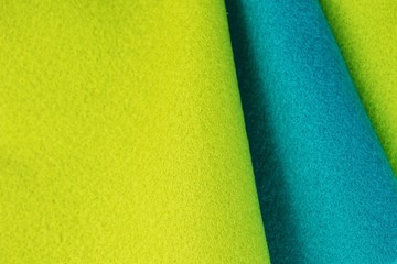 Green and blue felt set for background.