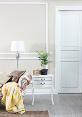 modern home decoration with armchair and yellow blank white classic door