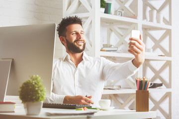 Man taking selfie in office
