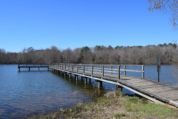 Wood pier on the lake in Wall Doxey State Park, Mississippi