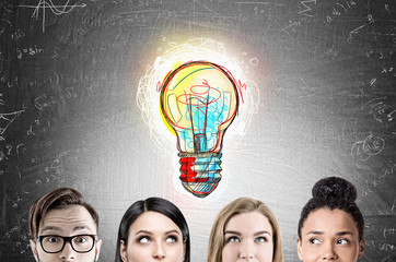 Business team faces, bulb, blackboard
