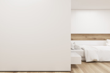 Bedroom with poster gallery, white wall, closeup