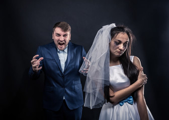 Bride with tearful face and terrible brutal groom