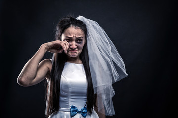 Bride with tearful face, unhappy marriage