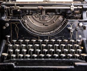 Retro grunge black typewriter closeup