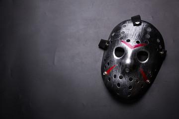 Hockey mask of serial killer isolated on black