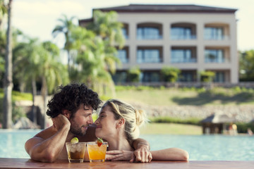 Couple relaxing together in resort pool