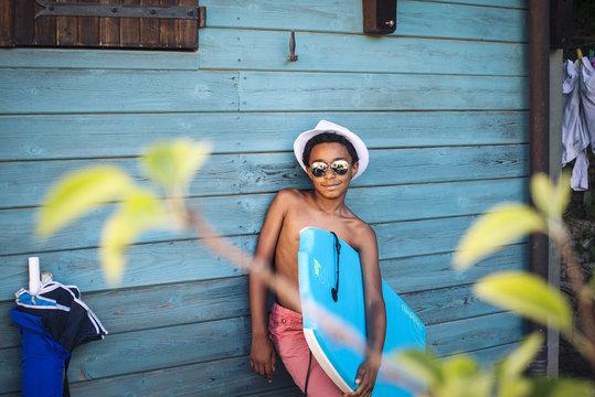 Boy holding bodyboard