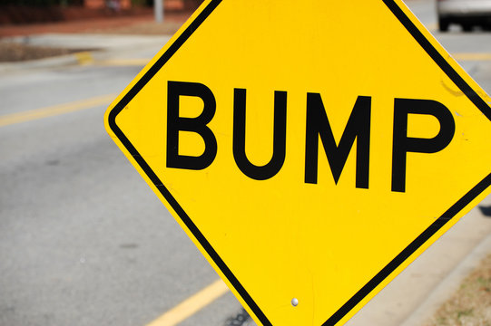 close up on bump sign at the side of street