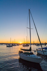 Sunset in marina. Sailboat, boat. Orange sky. San Diego. California