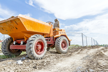 Small tipper, construction vehicle, container dumper