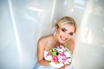 The bride with a beautiful smile.