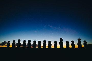 Fifteen standing moai on Ahu Tongariki against dramatic sunrise sky in Easter Island, Chile