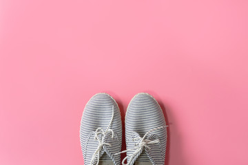 women sneaker isolated on pink background