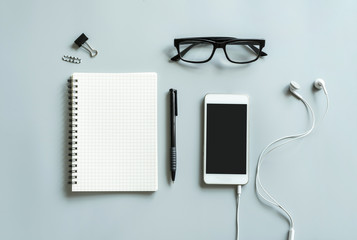 Blank notebook with cellphone desk office