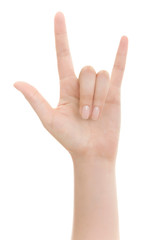 Hand shows the rock and roll sign or I love you sign isolated on a white background.