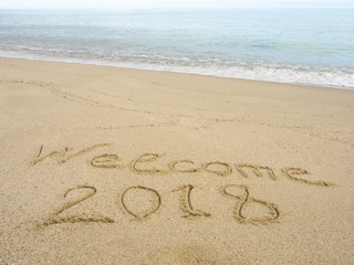 New year 2018 texture on sand